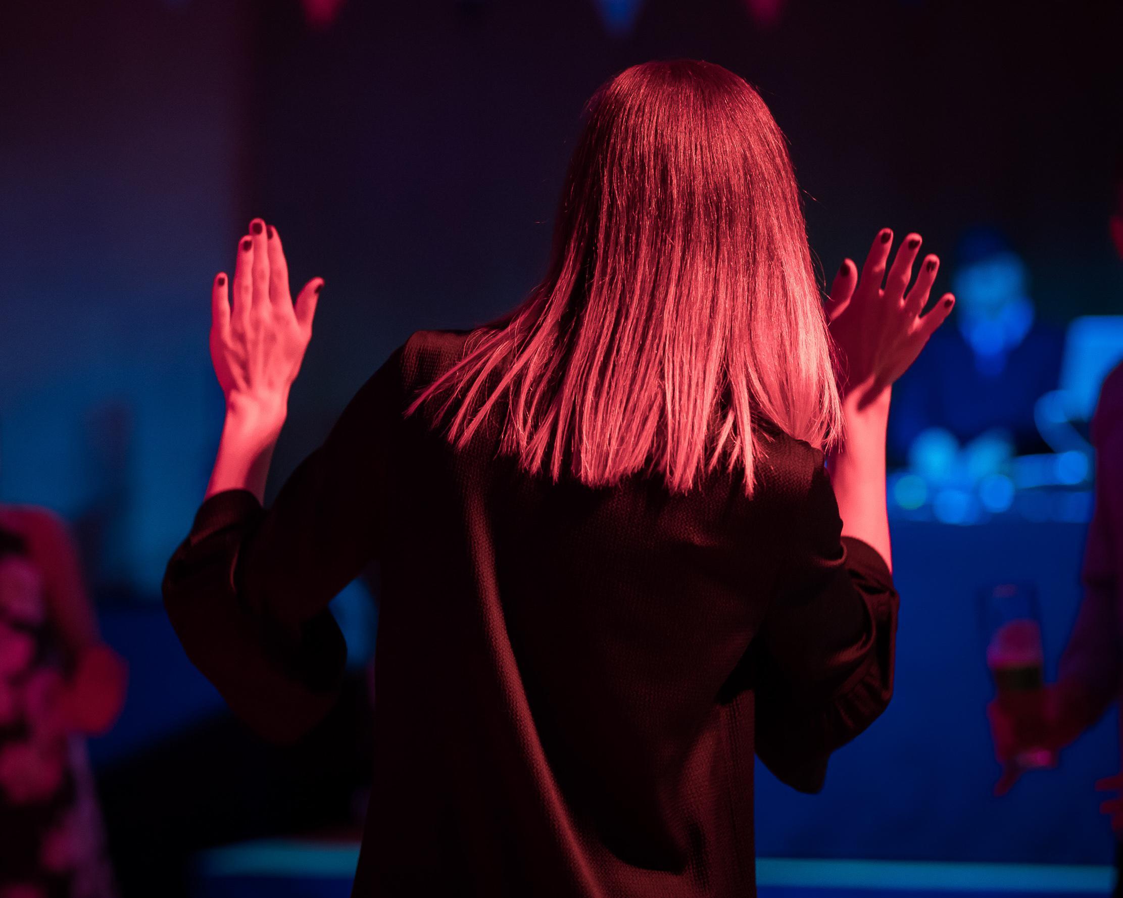 Woman raising hands
