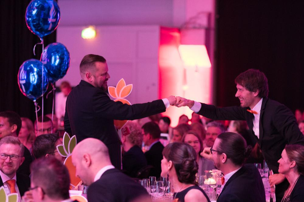 Mikko Laine and Toni Sinisalo fistbumping at the gala