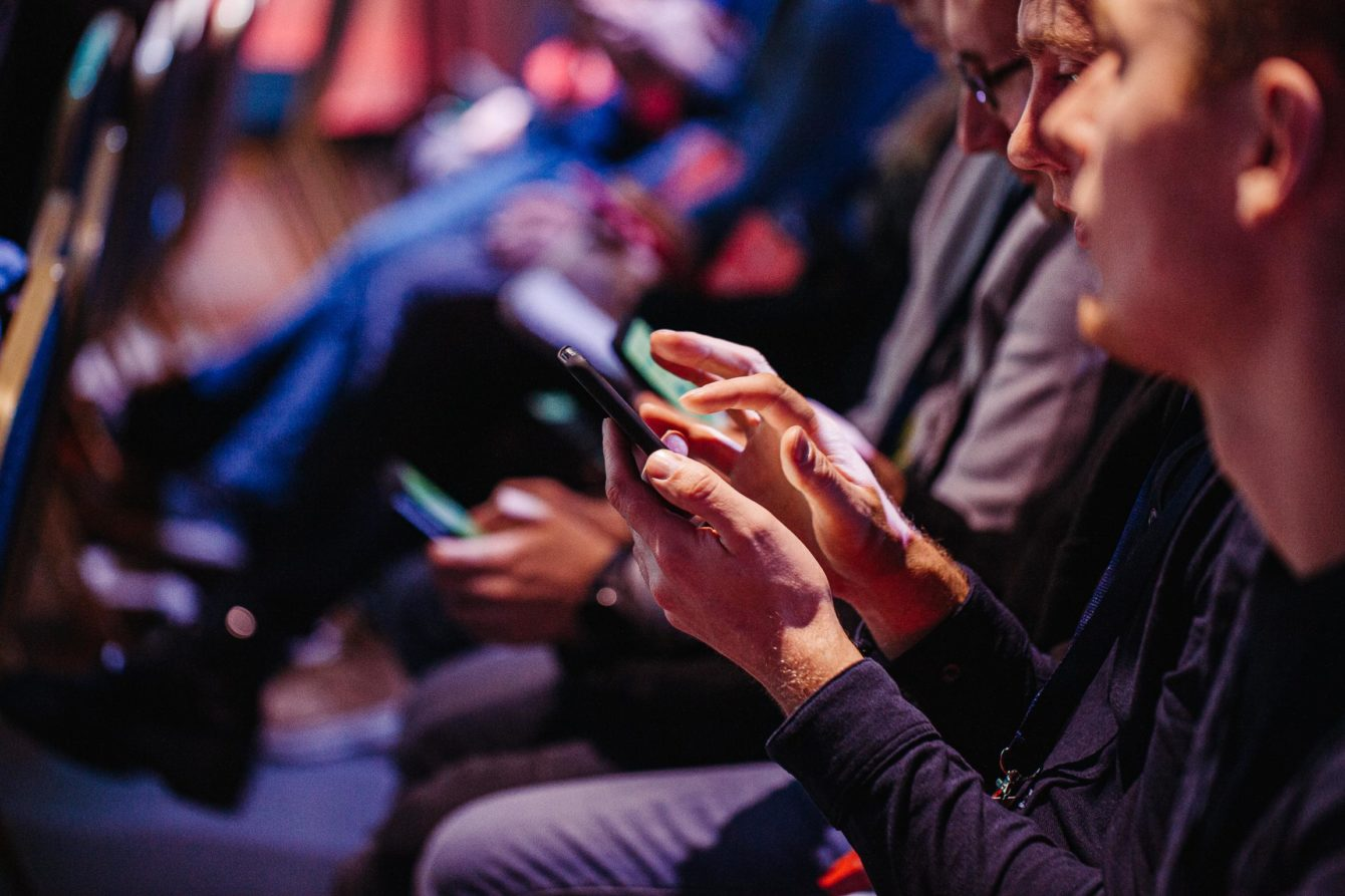 People in the audience with digital devices